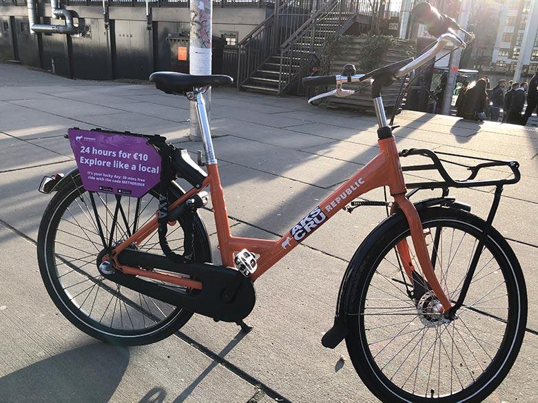 bright orange donkey republic bicycles in berlin