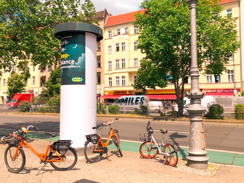 donkey republic and mobikes parked along the main road hermannstrasse in berlin