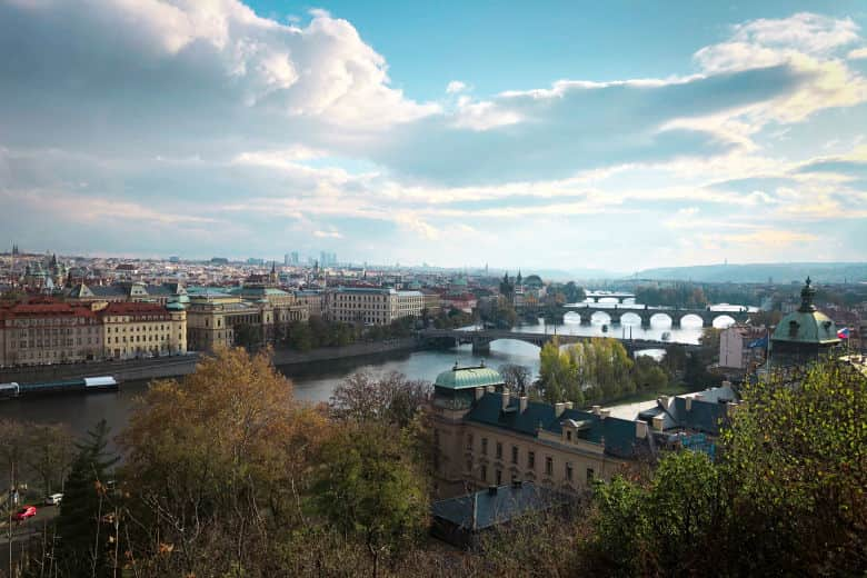 a great photography spot in prague from letna park overlooking the city and prague's many bridges