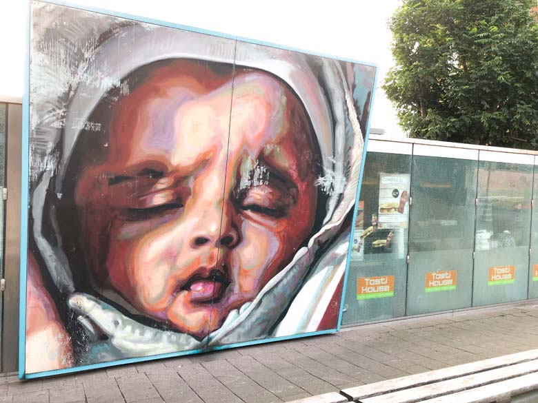 beautiful street art in rotterdam of baby sleeping
