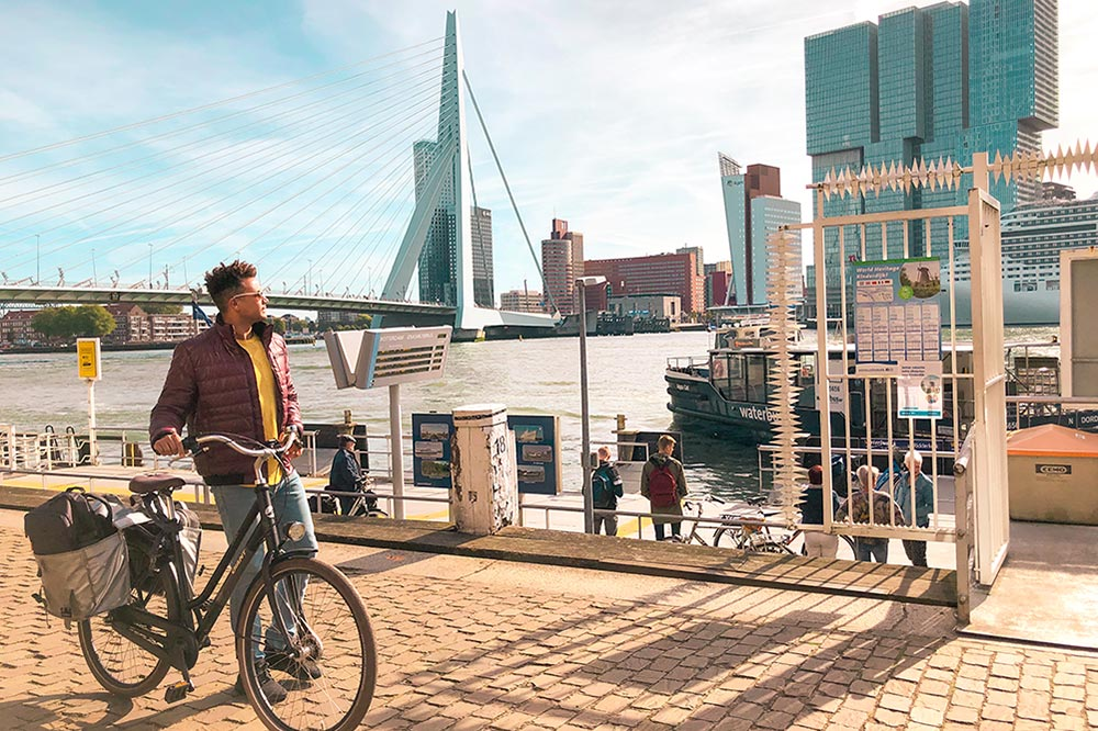 cycling to see the top things to do in rotterdam like erasmusbrug and maas river