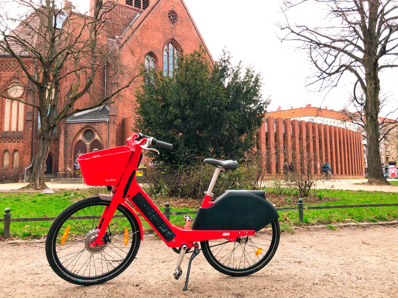 uber jump ebike parked in front of a red church in berlin